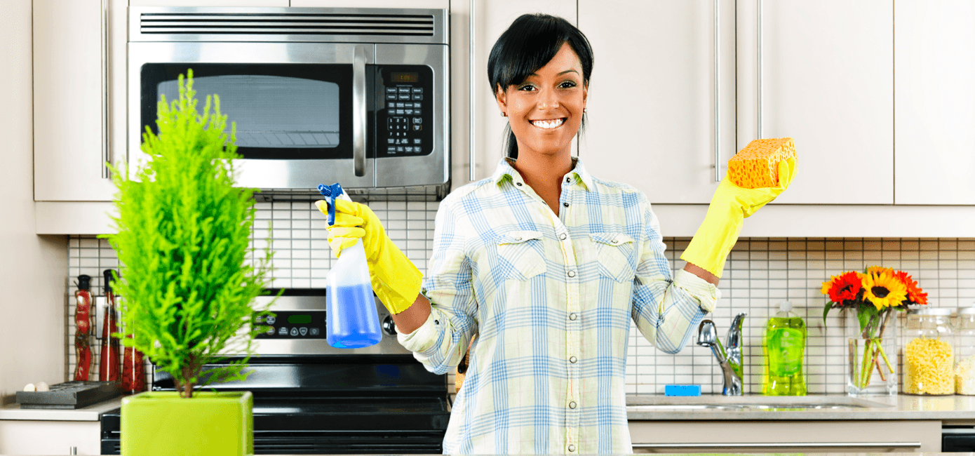 ultimate-home-cleaning-schedule-busy-families-smiling-woman.png