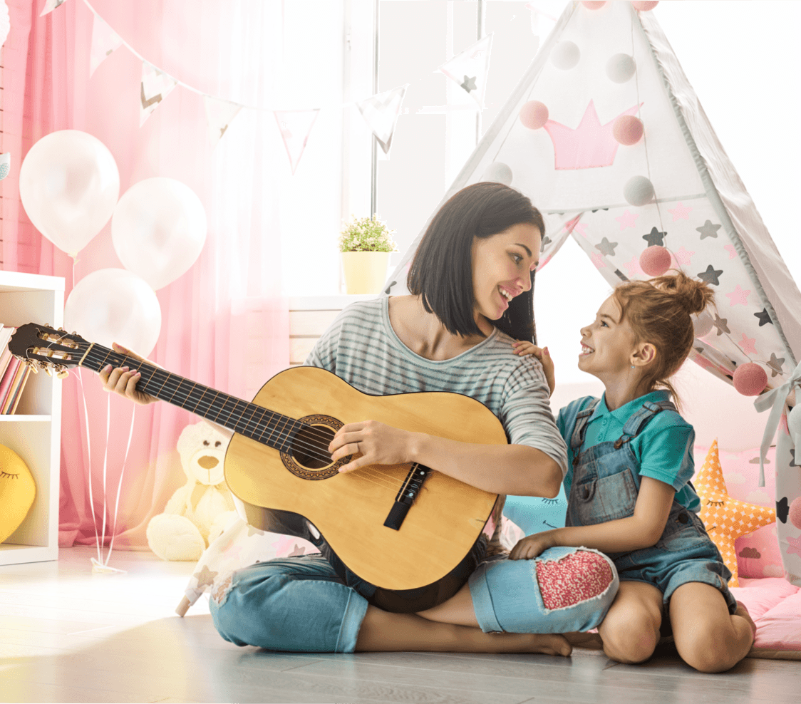 14 At-Home Activities to Spend Time With Your Kids Playing Guitar image