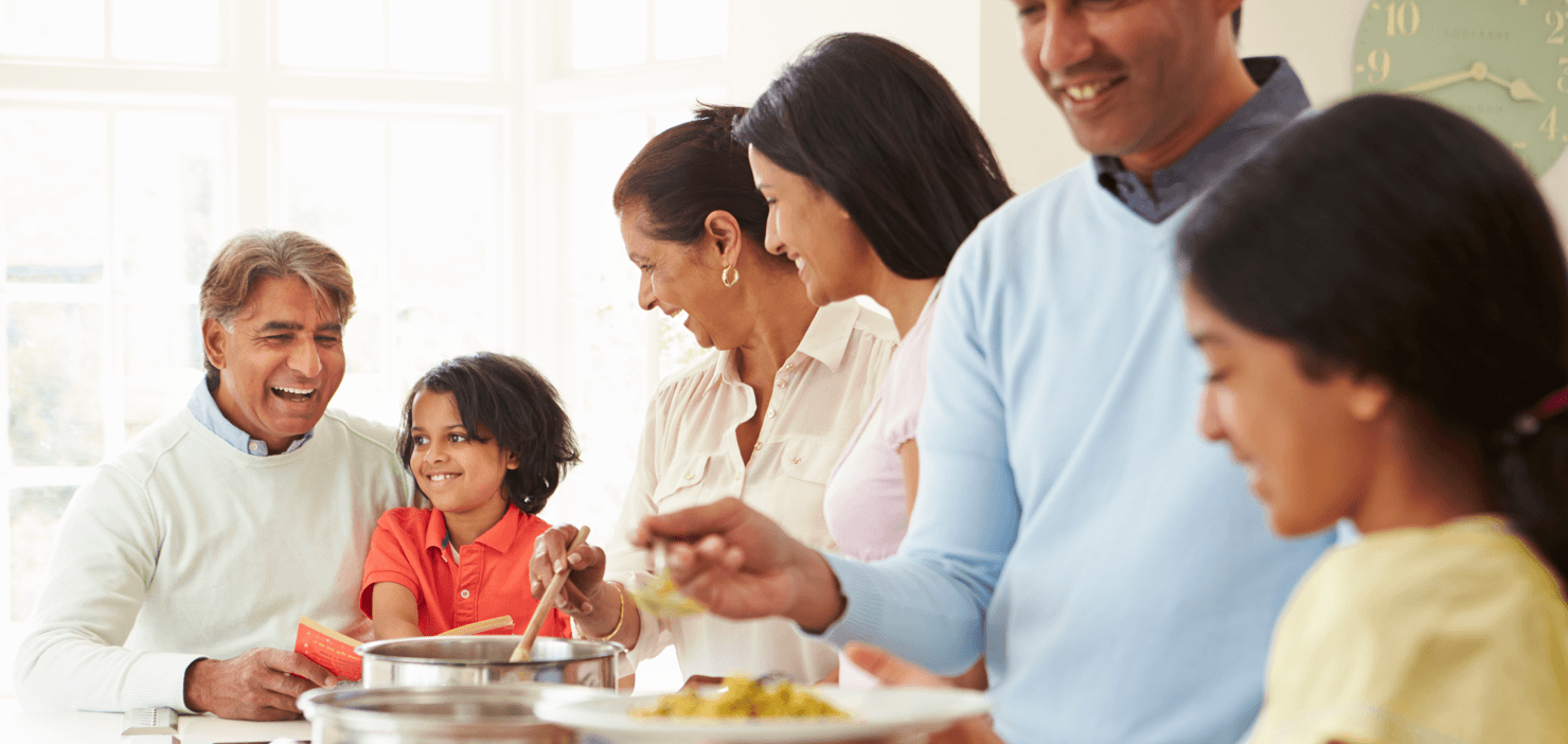 Things to Think About When Buying a Home With Extended Family Dinner Featured Image