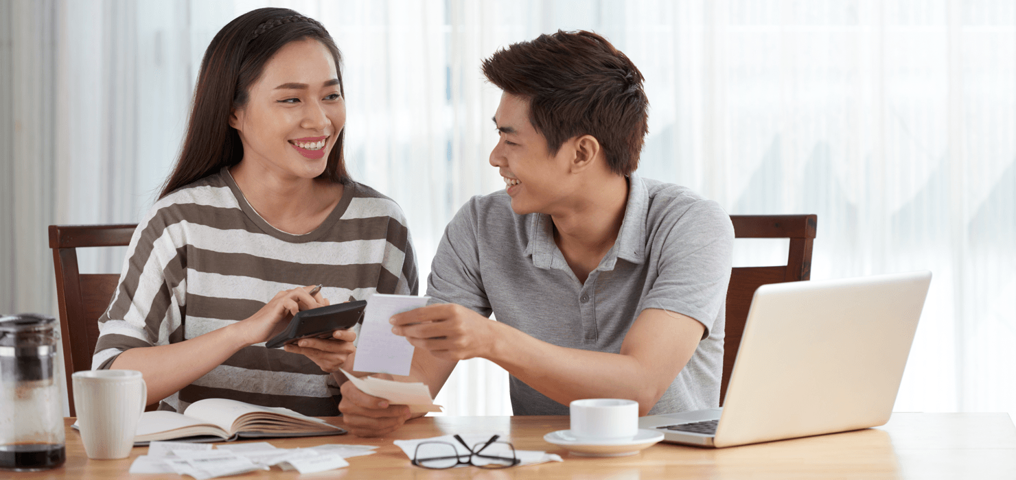 Manage a Mortgage While Paying Off Other Debts Couple Featured Image