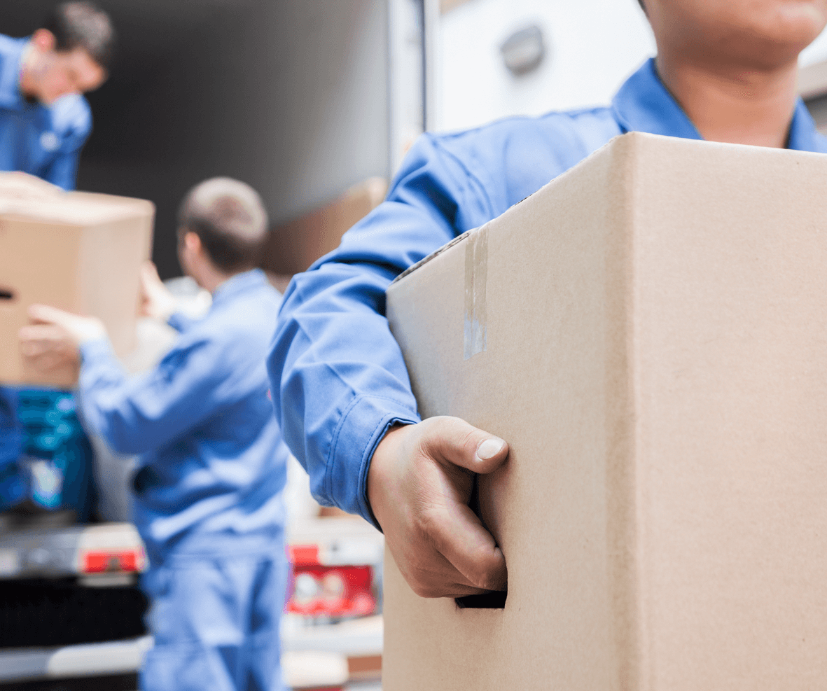Movers Unloading A Moving Van Image