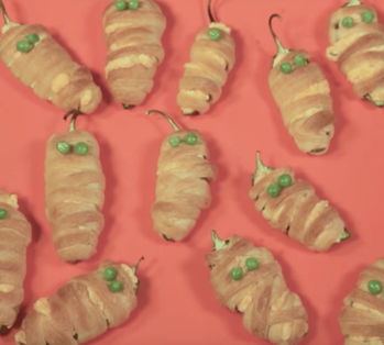 Throwing a Halloween Party? Add Some Gore to Your Décor With These Party Tips! Hot Pepper Mummies Image