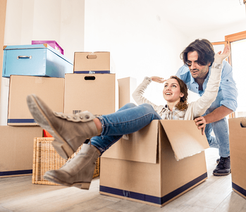 The Steps To Getting Approved For A First Time Mortgage Couple Moving Image