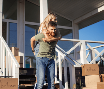 Is it Time to Stop Renting and Buy Your First Home? Couple Moving Image