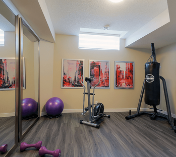 How to Compare Calgary Home Builders to Find the Best One For You Gym Image